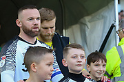 Wayne Rooney leads out the teams before the EFL Sky Bet Championship match between Derby County and Hull City at the Pride Park, Derby, England on 18 January 2020.