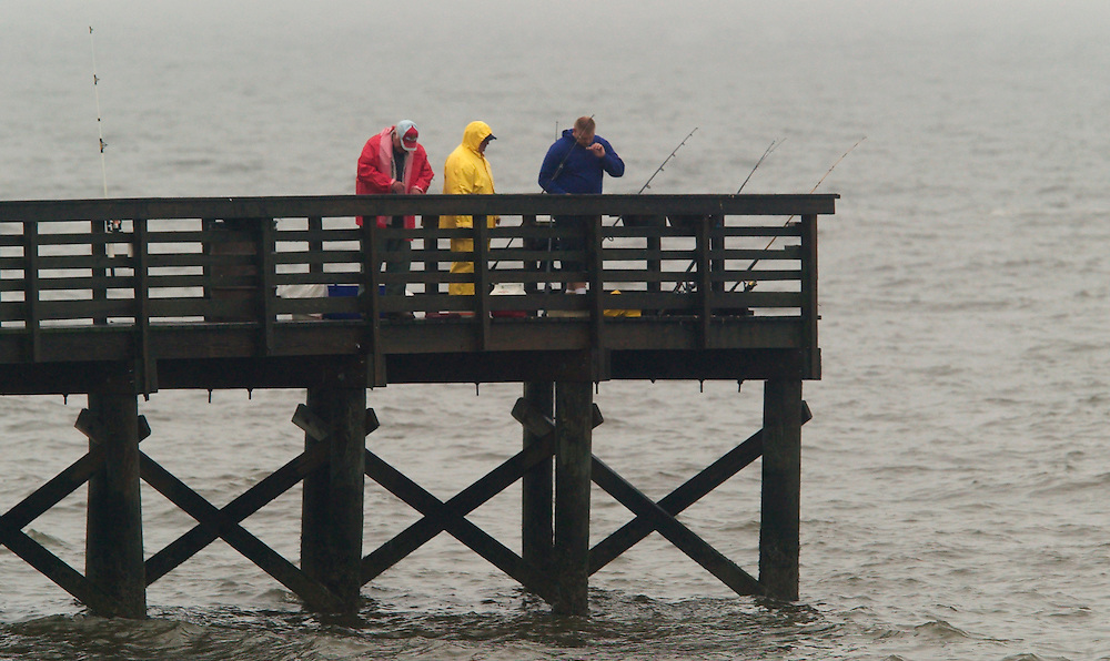 (PMONMOUTH) Port Monmouth 6/4/2003  Only fisherman braved the weather to fish at the spy house museum fishing pier in Port Monmouth.  The pier is park of the Monmouth County Park System.   Michael J. Treola Staff Photographer....MJT
