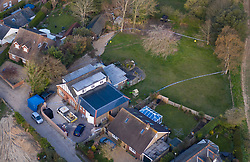 © Licensed to London News Pictures. 31/03/2020. Woodmancote, UK. A blue police evidence tent (L) sits in front of a house in Duffield Lane with police cordon tape also surrounding the back garden at the property in the village of Woodmancote near Chichester, West Sussex where the bodies of a family of four were found on Sunday. Police have started a murder investigation after they found the bodies and a dead dog after responding to a report of concern for the occupants of the house on Sunday evening. Photo credit: Peter Macdiarmid/LNP