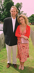 MR & MRS MIKE RUTHERFORD he is a member of the rock group Genesis, at a polo match in Sussex on 19th July 1998.MJD 48