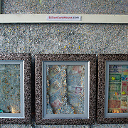 March 27, 2012 - Dublin, Ireland: Paintings hanging in a wall at the Billion Euro House art installation by the Irish artist Frank Buckley. ..Worthless euros, taken out of circulation and shredded by Irelands Central Bank, formes the interior walls of an apartment that Mr. Buckley does not own in a building left vacant by the countrys economic ruin...The artist decided to call the apartment  built from thousands of bricks of shredded, decommissioned cash (each brick contains, roughly, what used to be 50,000 euros)  the Billion Euro House. He reckons that about 1.4 billion euros actually went into it, but the joke, of course, is that it is worth simultaneously so much and so little...A large gravestone beside the main door, announces that Irish sovereignty died in 2010, the year that the government accepted an international bailout so larded with onerous conditions that the Irish will be paying for it for years to come. (Paulo Nunes dos Santos/Polaris)