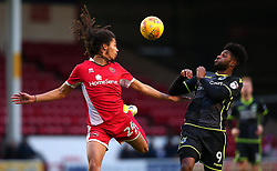 Kory Roberts of Walsall heads the ball clear of Ellis Harrison of Bristol Rovers - Mandatory by-line: Robbie Stephenson/JMP - 26/12/2017 - FOOTBALL - Banks's Stadium - Walsall, England - Walsall v Bristol Rovers - Sky Bet League One