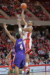 31 December 2008: Brandon Sampay gets tall with a shot over Nate Garner.  Illinois State University Redbirds extended their record to 13-0 with an 80-50 win over the Evansville Purple Aces on Doug Collins Court inside Redbird Arena on the campus of Illinois State University in Normal Illinois