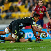 Sam Lousi scores during the Super rugby union game (Round 14) played between Hurricanes v Reds, on 18 May 2018, at Westpac Stadium, Wellington, New  Zealand.    Hurricanes won 38-34.