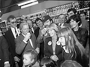 15/05/1982<br /> 05/15/1982<br /> 15 May 1982<br /> An Taoiseach, Mr Charles Haughey, canvasing with Fianna Fail bye-election candidate.  Eileen Lemass in Dublin West. 15/05/1982<br /> 05/15/1982<br /> 15 May 1982<br /> An Taoiseach, Mr Charles Haughey, canvasing with Fianna Fail bye-election candidate Eileen Lemass in Dublin West. Image shows Haughey and Lemass with Brendan Grace, canvassing the the Superquinn supermarket in the Superquinn Centre, Blanchardstown.