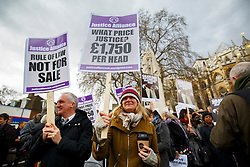 © Licensed to London News Pictures. 23/02/2015. LONDON, UK. Protesters marching to the parliament to mark Magna Carta's 800th anniversary and protest against the Global Law Summit and Chris Grayling, Justice Secretary in central London on Monday, 23 February 2015. Photo credit : Tolga Akmen/LNP