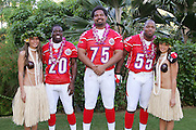 KO OLINA - FEBRUARY 10:  Baltimore Ravens 2005 NFL Pro Bowl AFC All-Stars (left to right: Ed Reed #20, Jonathan Ogden #75, and Terrell Suggs #55) pose with Hawaiian Hula girls for their 2005 NFL Pro Bowl team photo on February 10, 2005 in Ko Olina, Hawaii. ©Paul Anthony Spinelli