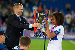 CARDIFF, WALES - Thursday, June 1, 2017: Olympique Lyonnais' Wendie Renard receives the trophy from UEFA president Aleksander Čeferin during the UEFA Women's Champions League Final between Olympique Lyonnais and Paris Saint-Germain FC at the Cardiff City Stadium. (Pic by David Rawcliffe/Propaganda)