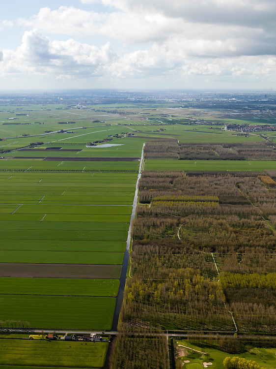 Nederland, Noord-Holland, Gemeente Waterland, 16-04-2012; zicht op polder De Purmer langs de as van de Middentocht, aan de horizon Amsterdam en Zaandam. .View on polder the Purmer and the city of Purmerend. In the back the skyline of Amsterdam. ..luchtfoto (toeslag), aerial photo (additional fee required);.copyright foto/photo Siebe Swart