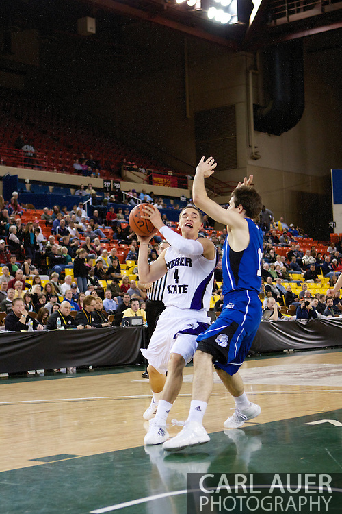 November 27th, 2010:  Anchorage, Alaska - Weber State sophomore Scott Bamforth (4) drives to the hoop in the Wildcat 82-81third place game victory over the Drake Bulldogs at the Great Alaska Shootout.