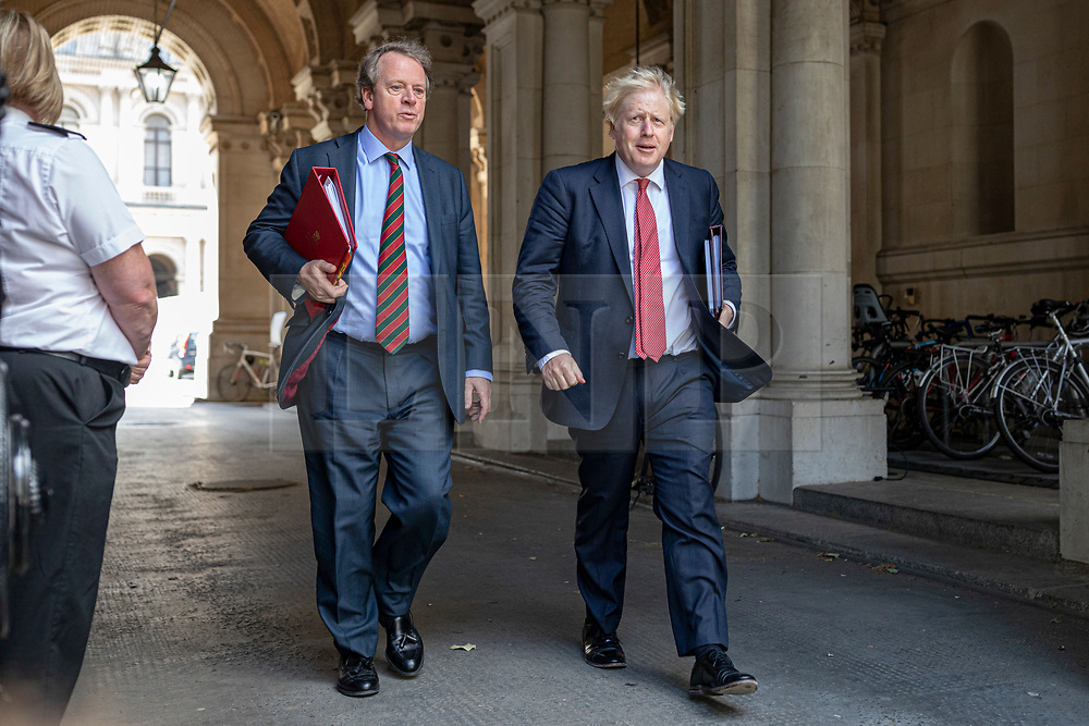 © Licensed to London News Pictures. 21/07/2020. London, UK. Prime Minister Boris Johnson (R) and Secretary of State for Scotland Alister Jack (L) return to Downing Street after the Cabinet meeting. The Intelligence and Security Committee has published the long-delayed report on Russia's influence over UK politics. Photo credit: Rob Pinney/LNP