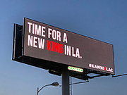 """General overall view of billboard promoting the recruitment Toronto Raptors free agent forward Kawhi Leonard to sign with the LA Clippers along the Interstate 5 freeway, Monday, June 24, 2019, in the Los Angeles suburb of Downey, Calif. The advertisement with black background reads """"Time for a New King in LA"""" and the hashtag #KAWHI2LAC."""