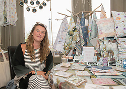 Across Portobello, Edinburgh artists artists revealed their work to the public for the start of this weekend's Art Walk Porty. A mixture of open studios, pop-up exhibition spaces, artists market and site-specitic art all over the Edinburgh suburb this weekend. The event runs from Fri-Sun Sept 2nd-4th 2016. Pictured Emily Bea at the Makers Market in the Dalriada.