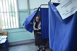 May 26, 2019 - Thessaloniki, Greece - A woman casts her vote at a polling station in the northern Greek city of Thessaloniki. Greeks vote for the European Parliament Elections. (Credit Image: © Giannis Papanikos/ZUMA Wire)