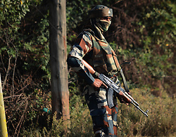 October 3, 2016 - Srinagar, Jammu and Kashmir, India - Indian troopers stand alert outside the base camp which was attacked by suspected militants at Baramulla on Oct 03 Indian controlled Kashmir. Suspected militants attacked an Indian army camp in the Indian portion of Kashmir ensuing a gunfight on late evening on Sunday, which ended in the wee hours of Monday morning, police said. (Credit Image: © Umer Asif/Pacific Press via ZUMA Wire)