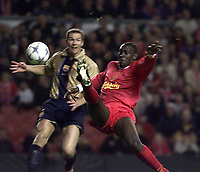 Fotball: Liverpool Emile Heskey gets a shot in despite the attentions of a Barcelona player.