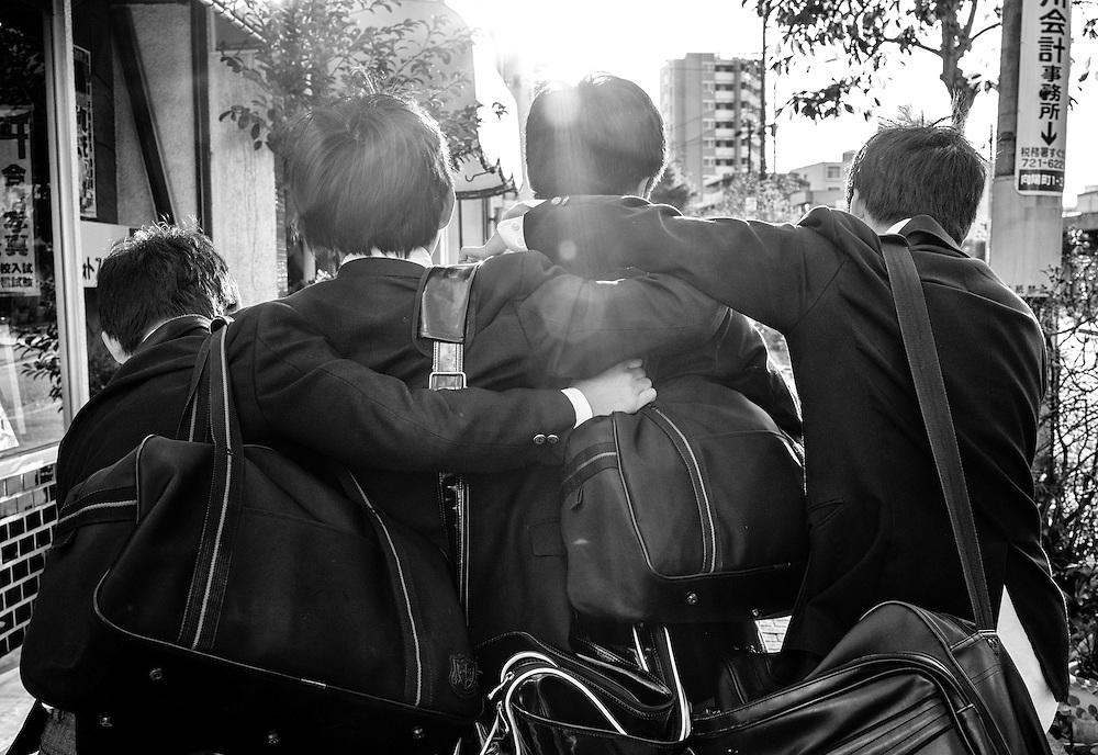 Students walk home from school in Nagoya, Japan.