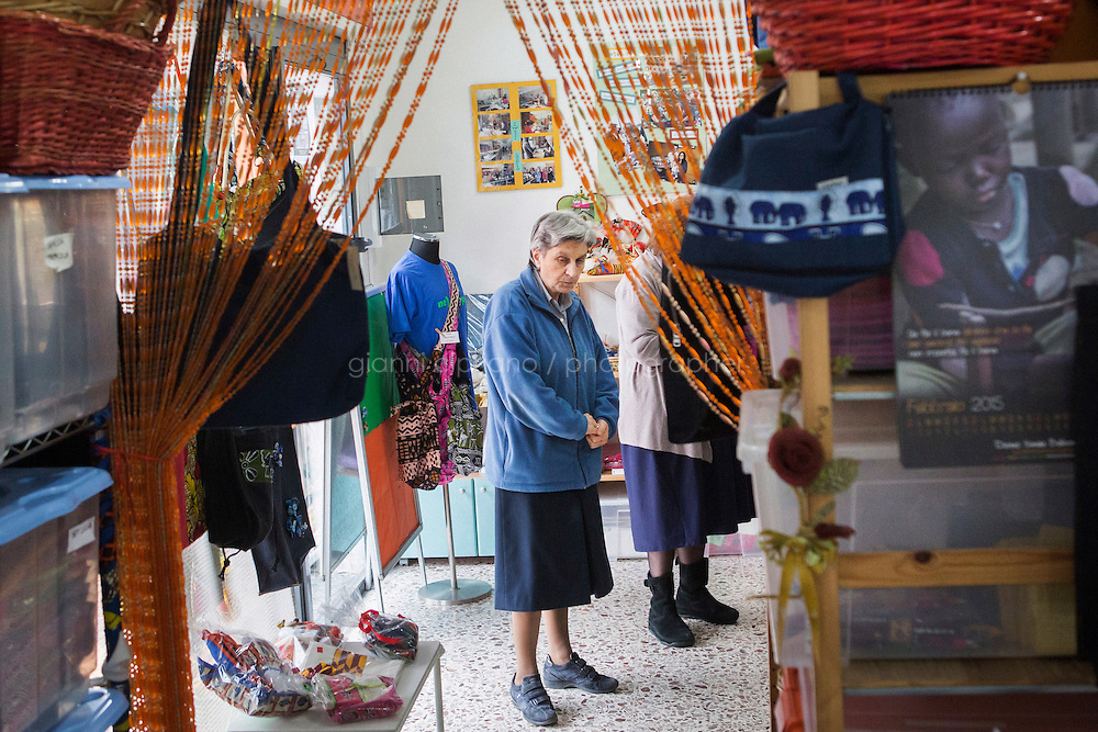 CASERTA, ITALY - 25 FEBRUARY 2015: Sister Rita Giaretta, founder of Casa Rut and of the New Hope ethnic tailor's shop, is here at the Bottega Fantasia (Fantasy Store), where handmade products made by ex-sex workers are sold in Caserta, Italy, on February 25th 2015.<br /> <br /> New Hope is an ethnic tailor's shop that makes a variety of colourful products working mainly african fabrics. The New Hope social cooperative, founded in 2014, promotes a training workshop for your immigrant women, many of which have children, that want to integrate in Italian society.