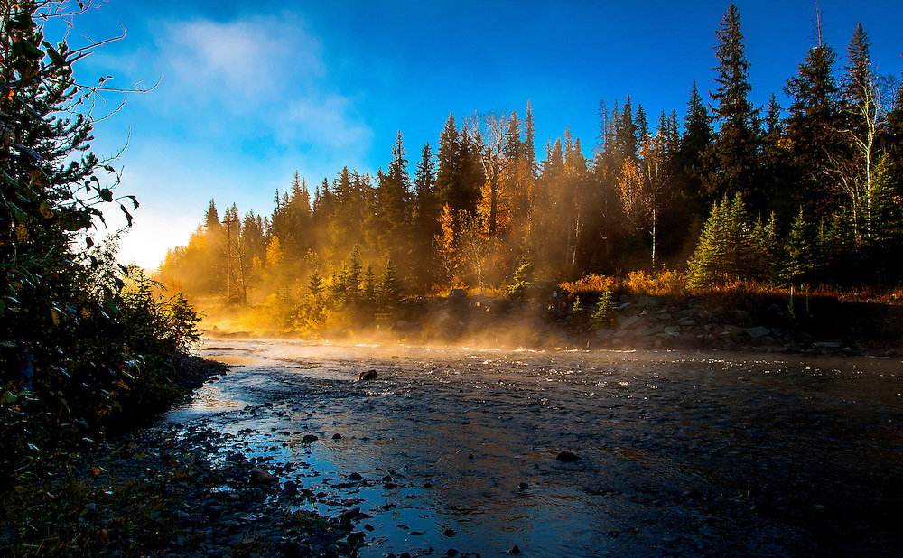 Early morning mist on the river. Glacier National Park, Montana.