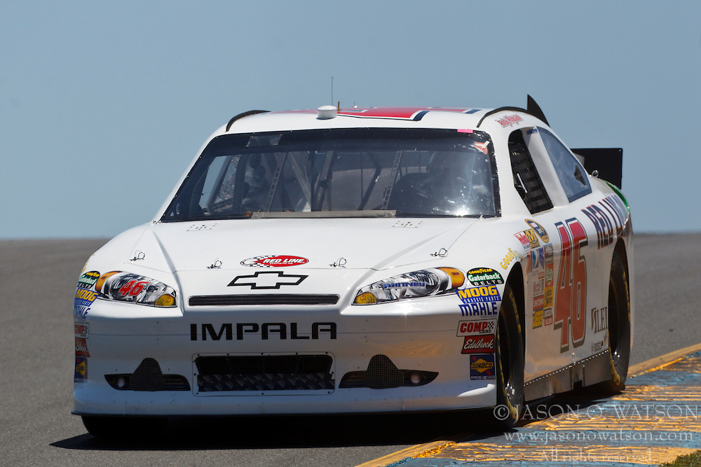 June 24, 2011; Sonoma, CA, USA;  NASCAR Sprint Cup Series driver Andy Pilgrim (46) drives past turn 3 during practice for the Toyota/Save Mart 350 at Infineon Raceway.