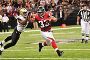 Atlanta Falcons RB Michael Turner strong arms New Orleans Sainst (LB) Jonthan Vilma 51 during their game Sunday Sept. 26,2010. The Super Bowl Champions New Orleans Saints play the Atlanta Falcons Sunday Sept 26, 2010 in New Orleans at the Super Dome in Louisiana.  The Saints and Falcons were tied at half time and went into overtime tied 24-24. Hartley missed a kick to win in overtime, the Falcons went on to win in OT with a field goal 27-24. PHOTO©SuziAltman.com