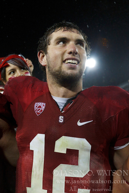 Nov 19, 2011; Stanford CA, USA;  Stanford Cardinal quarterback Andrew Luck (12) celebrates after the game against the California Golden Bears at Stanford Stadium.  Stanford defeated California 31-28. Mandatory Credit: Jason O. Watson-US PRESSWIRE