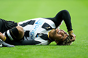 Newcastle United defender DeAndre Yedlin (#22) reacts in pain to a challenge during the EFL Sky Bet Championship match between Newcastle United and Barnsley at St. James's Park, Newcastle, England on 7 May 2017. Photo by Craig Doyle.