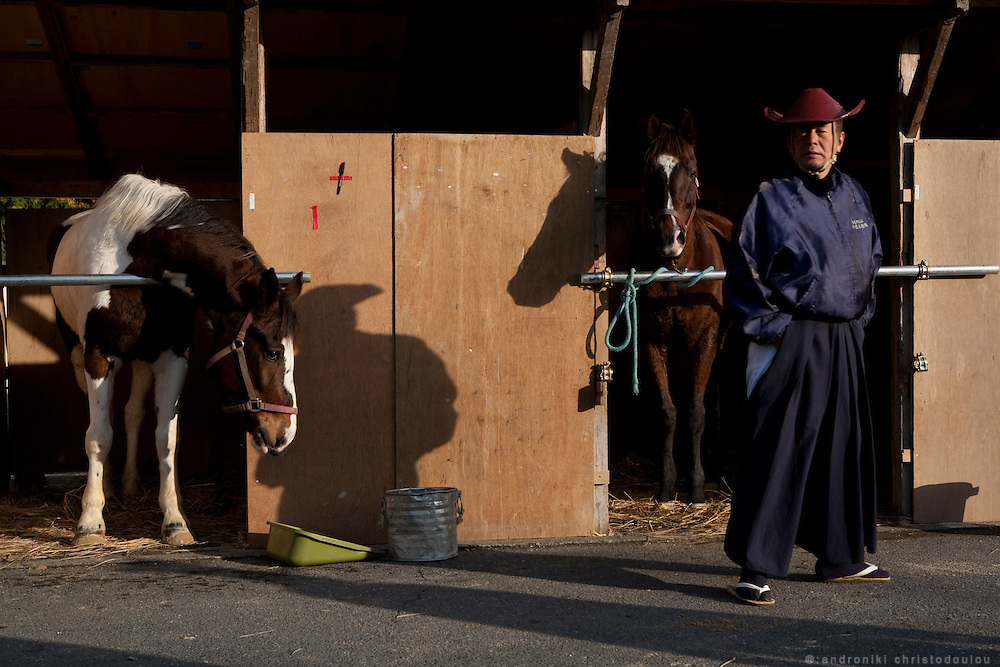 Yabusame archers in front of a temporary stable for the horses used in Yabusame, at Tado shrine