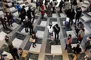 floor under the couple inside the renovated Tokyo station Japan