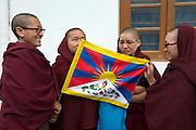 Tibetan nuns protest in Dharamshala during Tibet Uprising Day.