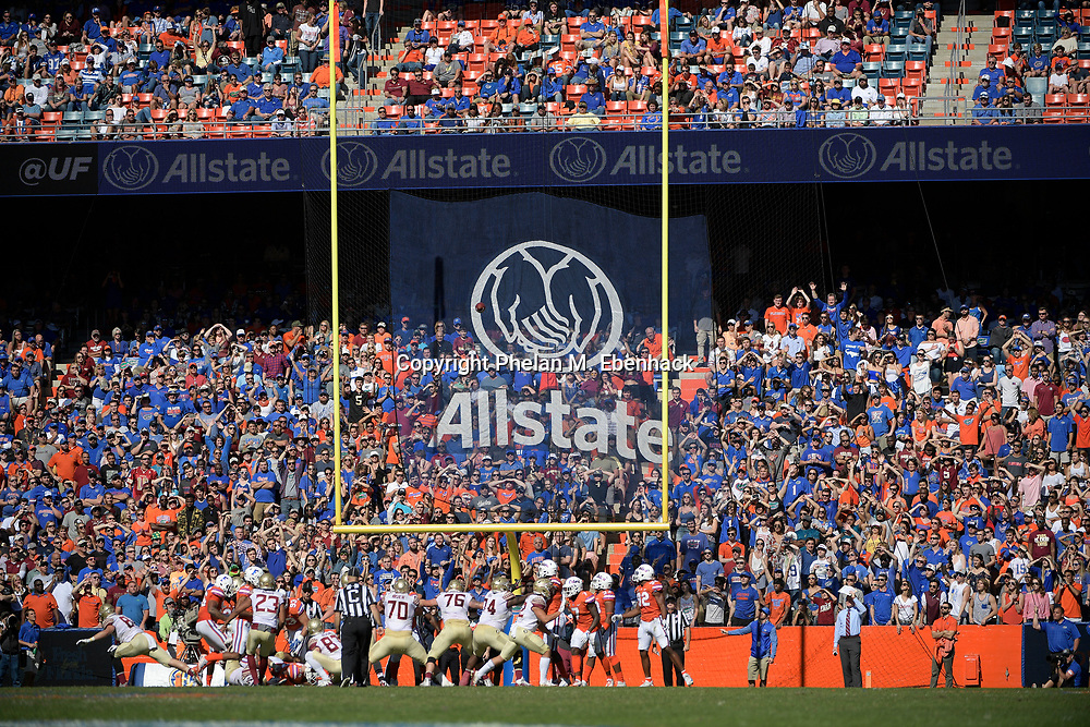 Florida State place kicker Ricky Aguayo (23) kicks an extra point during the first half of an NCAA college football game against Florida Saturday, Nov. 25, 2017, in Gainesville, Fla. (Photo by Phelan M. Ebenhack)