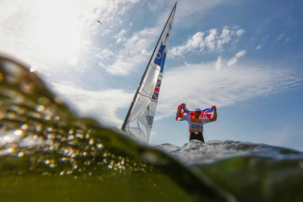 Giles Scott from Britain reacts after winning the Gold medal in the men's Finn class medal race of the Rio 2016 Olympic Games Sailing events in Rio de Janeiro, Brazil, 16 August 2016.