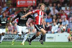 Brentford's Tony Craig passes the ball - Photo mandatory by-line: Patrick Khachfe/JMP - Mobile: 07966 386802 09/08/2014 - SPORT - FOOTBALL - Brentford - Griffin Park - Brentford v Charlton Athletic - Sky Bet Championship - First game of the season