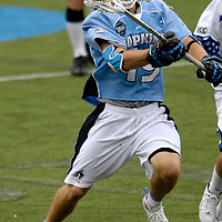 28 May 2007:  Johns Hopkins midfielder Brian Christopher (19) fights for a loose ball in the 4th quarter against the Duke University Blue Devils in the NCAA Division I Lacrosse Championship game.  The Johns Hopkins Blue Jays defeated the Duke Blue Devils 12-11 to win the NCAA Division I Lacrosse championship at M&T Bank Stadium in Baltimore, Md. .