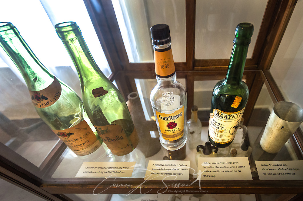Liquor bottles and a mint julep cup are displayed in a glass case at Rowan Oak, the home of writer William Faulkner, May 30, 2015, in Oxford, Mississippi. Faulkner was known to be a heavy drinker, rarely drinking while writing but binging after the completion of projects. (Photo by Carmen K. Sisson/Cloudybright)
