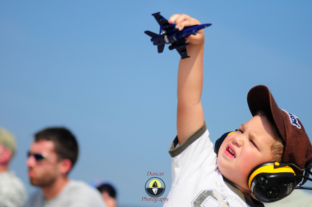 September 5, 2008 -- NAS BRUNSWICK, Maine. Owen LaBrecque, 3, of Biddeford plays with a toy F-15 at theThe Great State of Maine Airshow on Friday. The airshow visited Naval Air Station Brunswick for the last time this weekend, bringing The U.S. Navy Blue Angels, The U.S. Army Golden Knights and a wide variety of static displays and interactive exhibits. The show drew over 150,000 people over three days with no mishaps among the performers and no emergencies among the attendees. .Because NAS Brunswick is scheduled to be closed in 2011 by the Base Realignment Commission, there will not be another Navy-sponsored airshow at this location. Yet, the Local Redevelopment Authority, responsible for managing the property after the departure of the Navy,  has included an airshow on a list of possible future uses for the property.  U.S. Navy Photo by Mass Communication Specialist 1st Class Roger S. Duncan (RELEASED)