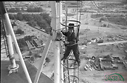 """AMAZING Photo Film discovered Documenting Work In Chernobyl <br /> Chernobyl worker Aleksandr Shubovskiy captures rare images <br /> <br /> During one of the days in 1979-80, when the erection of Ventilation Stack VT-2 common for the third and fourth (not existed at that time) Chernobyl NPP Units was coming to the end, Aleksandr Shubovskiy, who was working within a combined installation crew in a company named """"Spetsenergomontazh"""", arranged with the colleagues a small photo session on his own,They had their pictures taken.<br /> <br /> The author processed the film and put it on a wardrobe without printing until he had time to print the images. The moment to print the film somehow did not happen, while in February 1986 Aleksandr hit the road for a on a different site in Yakutia. And there he was caught by news about the accident at Chernobyl.<br /> <br /> A year later, when a Aleksandr  managed to get into his looted flat in the evacuated Pripyat, he discovered an untouched package with films. He brought them home and… forgot for almost 40 years…the printed photographs which no one and never have seen before until now<br /> <br /> Photo shows: Welding at height.<br /> ©Aleksandr Shubovskiy/Exclusivepix Media"""