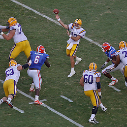 October 8, 2011; Baton Rouge, LA, USA;  LSU Tigers quarterback Jarrett Lee (12) throws a pass against the Florida Gators during the fourth quarter at Tiger Stadium. LSU defeated Florida 41-11. Mandatory Credit: Derick E. Hingle-US PRESSWIRE / © Derick E. Hingle 2011