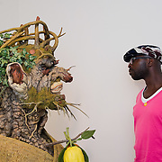 """VENICE, ITALY - MAY 28:   A man looks at sculpture interpretation of Arcimboldo's """"Winter"""" portrait by Philip Haas at the press preview of Ileana Sonnabend """"Un Ritratto Italiano"""" on May 28, 2011 in Venice, Italy. The """"An Italian Portrait"""" Exhibition will be held in dedication to art dealer and collector Ileana Sonnabend, and presentsmore than 60 worksby Italian and international artists such as Pistoletto, Merz, Fontana, Manzoni, Rauschenberg, Koons, Sugimoto, Esser."""