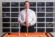 corporate portrait on location,by miami photographer,matthew pace,of Wes Emmer,Onboard Media,portrait,with pool table,at office