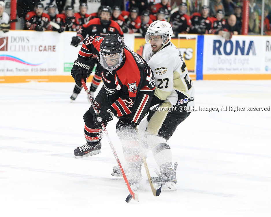 TRENTON, ON - Apr 18, 2016 -  Ontario Junior Hockey League game action between Trenton Golden Hawks and the Georgetown Raiders. Game 3 of the Buckland Cup Championship Series  at the Duncan Memorial Gardens in Trenton, Ontario. Josh Dickinson #28 of the Georgetown Raiders and Danny Hanlon #27 of the Trenton Golden Hawks battle for the puck during the third period.<br /> (Photo by Tim Bates / OJHL Images)