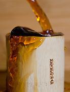 Pouring pu-erh tea into a bamboo tea cup.