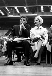 Elizabeth Taylor and Richard Burton stars of the film 'Cleopatra', at the ring side at Wembley, London for the heavy weight match between Henry Cooper and Cassius Clay.