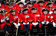 Chelsea Pensioners - the Corps of war veterans cared for at the Royal Hospital in Chelsea and known for their distinctive red uniforms and tricorn hats.They proudly display their medals won for valour.
