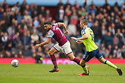 Aston Villa midfielder Robert Snodgrass (7) makes a run with Derby County defender Alex Pearce (16) looking to make a tackle during the EFL Sky Bet Championship match between Aston Villa and Derby County at Villa Park, Birmingham, England on 28 April 2018. Picture by Jon Hobley.