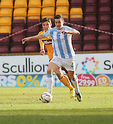 Dundee's Thomas Konrad strides away from Motherwell's John Sutton - Motherwell v Dundee, SPFL Premiership at Fir Park<br /> <br />  - &copy; David Young - www.davidyoungphoto.co.uk - email: davidyoungphoto@gmail.com