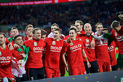 CARDIFF, WALES - Tuesday, October 13, 2015: Wales' Simon Church, Neil Taylor, Emyr Huws, Andy King, Ben Davies, Tom Lawrence, Ashley 'Jazz' Richards, David Edwards celebrate qualifying for the finals after the 2-0 victory over Andorra during the UEFA Euro 2016 qualifying Group B match at the Cardiff City Stadium. (Pic by Barry Coombs/Propaganda)