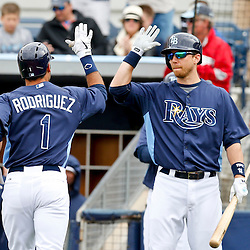 Mar 2, 2013; Port Charlotte, FL, USA; Tampa Bay Rays second baseman Sean Rodriguez (1) celebrates with teammate Ben Zobrist after hitting a solo homerun against the Baltimore Orioles during the bottom of the fifth inning of a spring training game at Charlotte Sports Park. Mandatory Credit: Derick E. Hingle-USA TODAY Sports