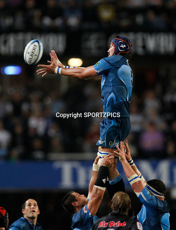 Victor Matfield takes a lineout ball during the Super 15 match between the Sharks and the Bulls played in Durban on the 21 May 2011..Photo by: SPORTZPICS