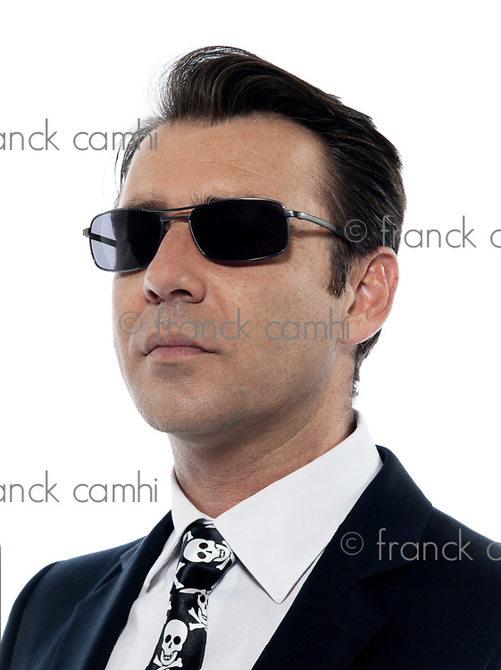 one Man caucasian criminal portrait serious wih sunglasses in studio isolated on white background
